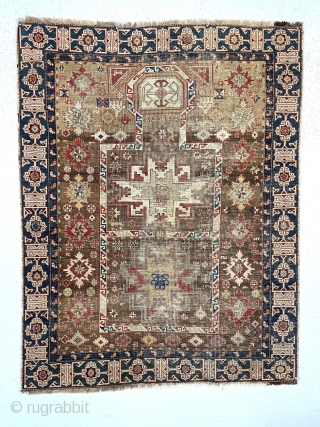 """Early Caucasian prayer rug. Kuba?Uncommon design featuring rare combination of lesghi stars, rounded """"head"""" mihrab, large """"snowflakes"""", hands and nicely drawn """"Kufic"""" border. Complete but overall thin with very low pile and  ..."""