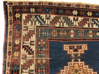 Early small Kazak. Spacious and fluid drawing. An older example of a well known design group. All natural colors. Overall even low pile with scattered wear, heavy brown oxidation and creases as  ...